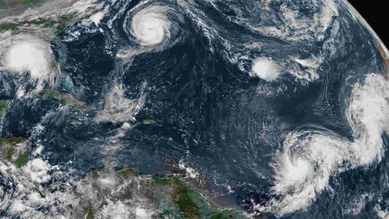 Atlantic hurricane floods southeast US, while wildfires burn west US