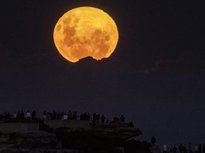 A super blood moon lights up the sky, heralding the apocalypse